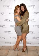 HAWTHORNE, NJ - MARCH 30: Melissa Gorga (L) and Teresa Giudice attend envy By Melissa Gorga Fashion Show at Macaluso's on March 30, 2016 in Hawthorne, New Jersey. (Photo by Paul Zimmerman/WireImage)